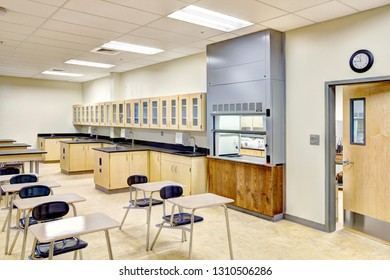 Rigby Idaho, USA August 28, 2013 A science classroom with desks, tables, lab area, and biology models, in a new modern high school