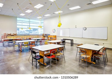 Rigby Idaho, USA August 28, 2013 An art classroom with desks, tables, work area, and white boards, in the new modern Rigby High School.