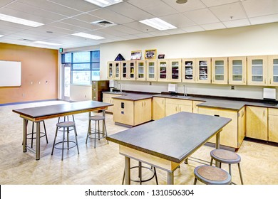 Rigby Idaho, USA August 28, 2013 A science classroom with desks, tables, lab area, and biology models, in a new modern high school.