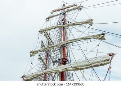 The rigging of  foreamast and mainmast with rotated yards and sails against the blue sky, Hundested, Denmark, July 31, 2018