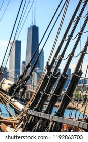 Rigging and ropes on a historic sailing ship downtown Chicago skline in the background