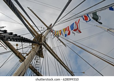 The rigging of a sailing ship, decorated with flags