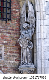 The right angel at the bottom of the gate of St. John's Hospital in Bruges, Belgium