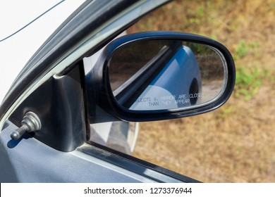 Right car miror. Open car door and mirror to the right side. Car rearview mirror with warning Objects in mirror are closer than they appear.