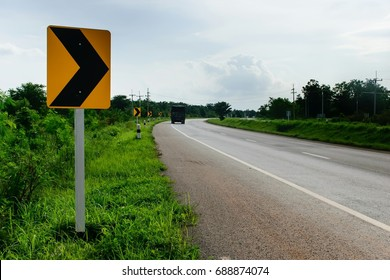 Right curve sign on white background.