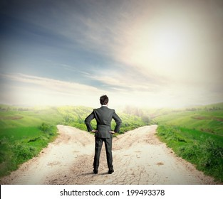 The right destination concept with businessman at crossroad