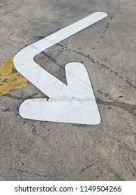 right down arrow on the concrete road