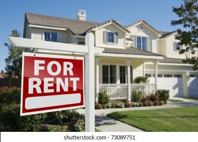 Right Facing Red For Rent Real Estate Sign in Front of Beautiful House.