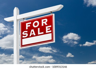 Right Facing For Sale Real Estate Sign Over Blue Sky and Clouds With Room For Your Text.