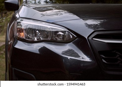 Right front of the lights of a subaru xv dark gray car four by four