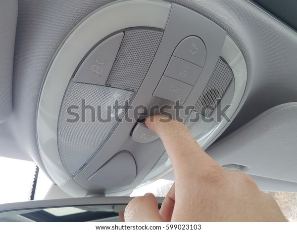 Right hand activating solar sunroof buttons. Glide opening hatch. Luxury car, modern buttons, summer, sun, trip.