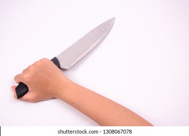 A right hand  holding a stainless steel knife in stabbing gesture. Isolated on white background.