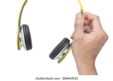 right hand holding yellow headphone on white background