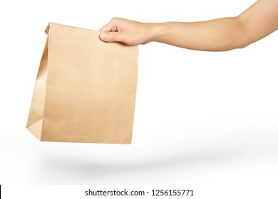 Right hand holidng a brown paper bag isolated on white with clipping path.