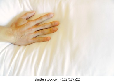 Right hand pressure pillow or bedding. Soft pillow good sleep, good health. Flat Lay. Copy Space. Health care.