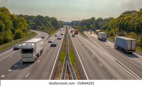 Right hand side Evening Traffic on the A12 Motorway through the Veluwe forest. One of the Busiest highways in the Netherlands