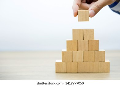 Right hand side  Fifteen Wooden cube Stacked in  Pyramid shape  without graphics for Business and design concept, Symbol of leadership, Teamwork and Growth.
