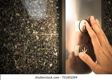 right hand touch up botton of elevator, choose up or down concept