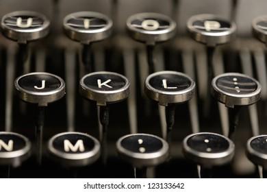 Right home row keys on an antique typewriter. Close-up of the right half of home row keys on an old typewriter.
