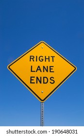 """The """"Right lane ends"""" sign in the Southern Californian sun."""
