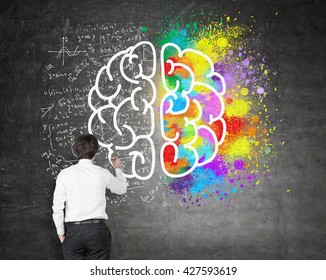 Right and left hemispheres, creative and analytical thinking concept with businessman drawing sketch on chalkboard