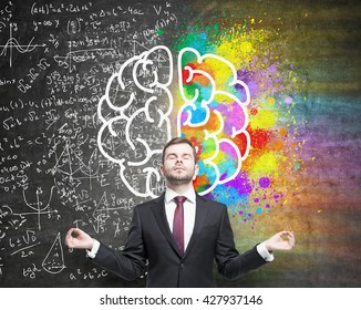 Right and left hemispheres, creative and analytical thinking concept with businessman meditating against chalkboard with sketch