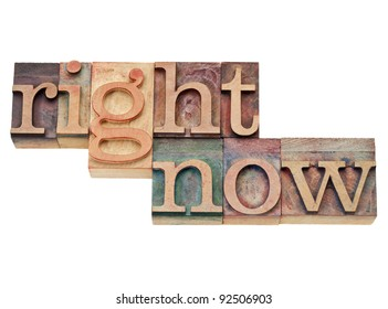 right now - action concept - isolated text in vintage wood letterpress printing blocks, stained by color inks