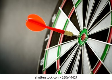 Right on target concept using dart in the bullseye on dartboard