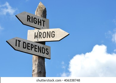 """Right, wrong, it depends"" - wooden signpost, cloudy sky"