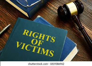 Rights of victims book on the wooden surface.