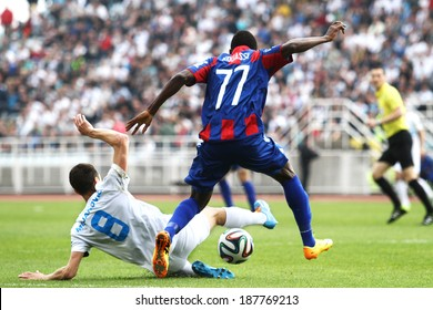 RIJEKA, CROATIA APRIL 06: soccer derby match NK Rijeka (white) vs. NK Hajduk Split (blue) on July 06, 2014 in Rijeka. Rijeka's Goran Mujanovic is tackling Hajduks's Jean Evrard Kouassi.
