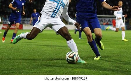 RIJEKA, CROATIA APRIL 06: soccer derby match NK Rijeka (white) vs. NK Hajduk Split (blue) on July 06, 2014 in Rijeka. Close up of two opposite players with the Brazuca ball.