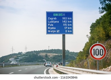 Rijeka, Croatia - August 1th, 2018 : Traffic on the Rijeka Bypass, highway from Smrika place to Hreljin with sign of main cities distance and speed limit of 100 km/h in Rijeka, Croatia.