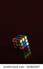 RIJEKA, CROATIA - MARCH 22, 2015: Rubik's cube on the dark background. Rubik's Cube on a dark background with a reflection.
