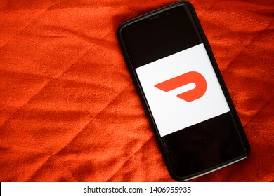 Rijeka, Croatia - May 24, 2019: DoorDash Food Delivery app fast food delivery application on smartphone screen close-up DoorDash app logo on Android.
