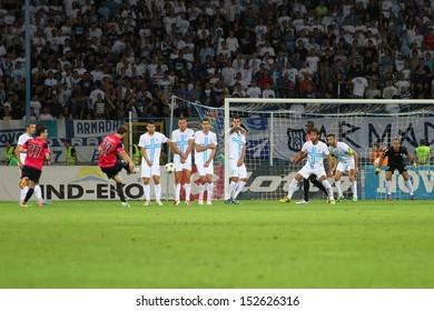 RIJEKA, CROATIA SEPTEMBER 2: soccer derby match NK Rijeka (white) vs. NK Lokomotiva (black-pink) on September 2, 2013 in Rijeka.