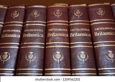 Rijeka, Croatia, September 25, 2018. Encyclopedia Britannica series books lined on the library bookshelf