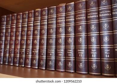 Rijeka, Croatia, September 25, 2018. Encyclopedia Britannica series lined on the bookshelf in library, side view