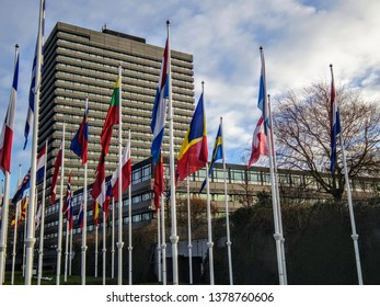 Rijswijk, ZH, Netherlands - January 17 2015: European Patent Office old tower building with flags in foreground, blue sky with clouds