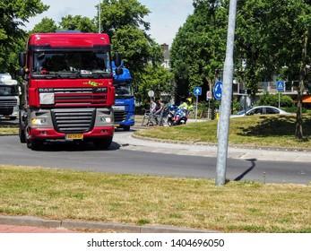 Rijswijk, ZH, Netherlands - June 20 2015: semi-truck parade Kraaienrit, charity event to provide fun for handicapped people, honking trucks