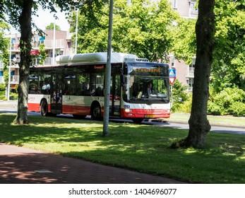Rijswijk, ZH, Netherlands - June 20 2015: semi-truck parade Kraaienrit, charity event to provide fun for handicapped people, honking trucks, HTM bus