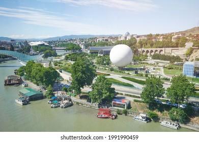 Rike park on Kura river on Bright sunny day background - Shutterstock ID 1991990459