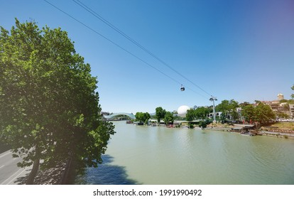 Rike park on Kura river in Tbilisi city on bright sunny day - Shutterstock ID 1991990492