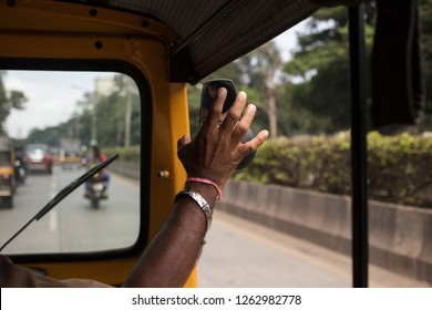 A rikshaw driver honking, India.