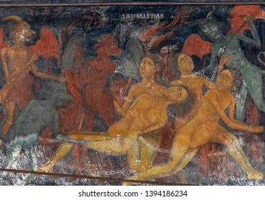 RILA, BULGARIA - APR 13, 2019 - Exterior fresco paintings of sinners condemned to hell, , Rila orthodox monastery, Rila, Bulgaria