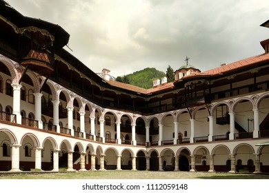 RILA MONASTERY, BULGARIA - APRIL 27 2018: Arcade that surrounds the cloister of the Rila monastery.  It was founded by the hermit Saint John of Rila (876 - 946) in the 10th century