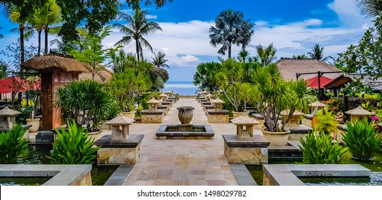 Rimba Jimbaran by Ayana Hotel, Bali, Indonesia, Asia - September 07, 2019: Luxury and modern five star village resort with restaurant and shops on small alleys surrounded by lagoons with koi fish.