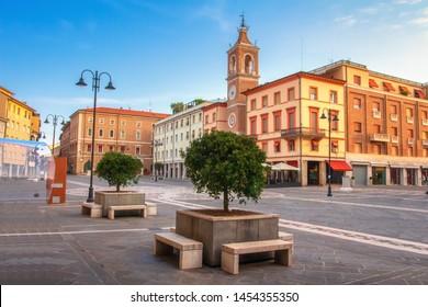 Rimini cityscape, Italy. Central square of Rimini. Square of the Three Martyrs in Rimini with the ancient clock tower.