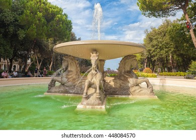 Rimini, Italy - Circa August 2013: Fountain of Four horses in Federico Fellini park at sunny summer day.