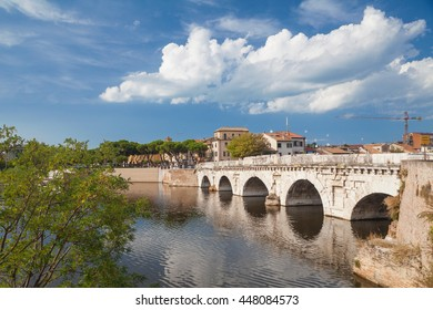 Rimini, Italy - Circa August 2013: Bridge of Tiberius in the center of city at sunny summer day.